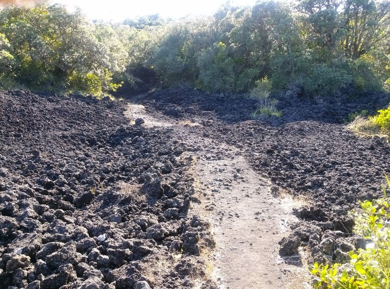 Watch your footing as you make your way to the summit through the volcanic basalt.