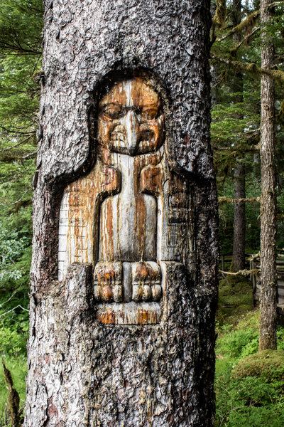 A beautiful wood carving stands guard along the Forest Trail.