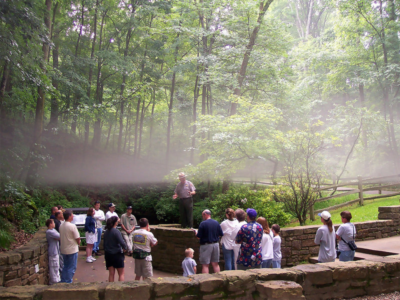 A tour group gathers around the Historic Entrance before entering Mammoth Cave. Photo credit: NPS Photo.