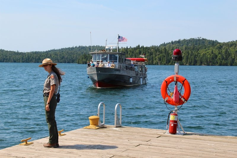 A park ranger awaits the arrival of the ferry at Isle Royale Park.