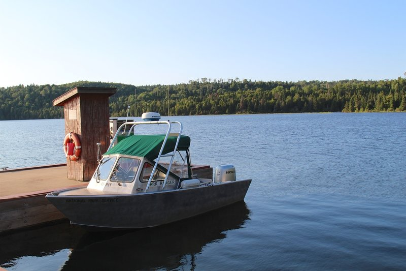 A park ranger's boat stands moored at the dock in Windigo.