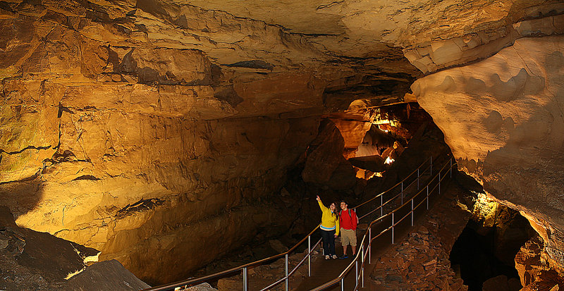 Visitors enjoy the narrow passage of Thanksgiving Hall in Mammoth Cave. Photo credit: NPS Photo.