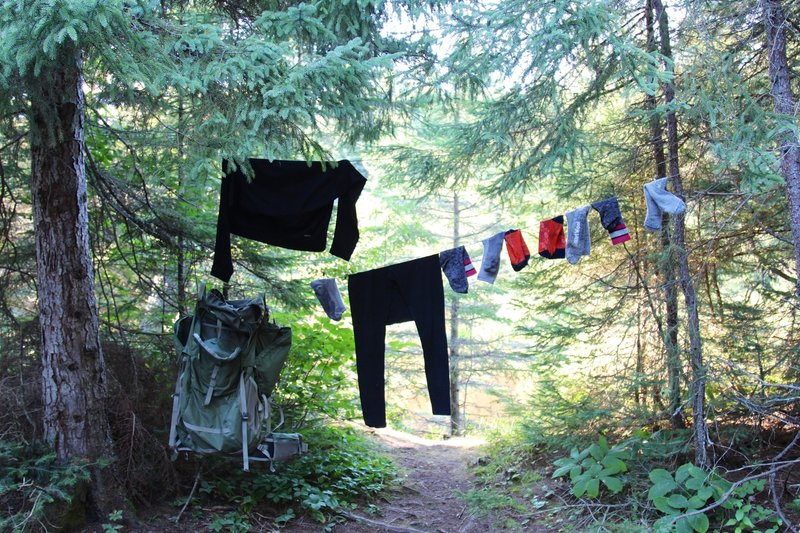 Someone's belongings hang to dry near the trail and Washington Creek Campground.