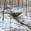 A small alcove hides under a snowy blanket along the Buffalo Creek Trail.