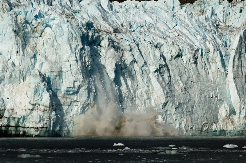 Ice calves off of the Margerie Glacier. Photo credit: NPS Photo.