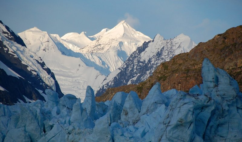 Sunrise hits the Fairweather Mountains above the Margerie Glacier. Photo credit: NPS Photo.