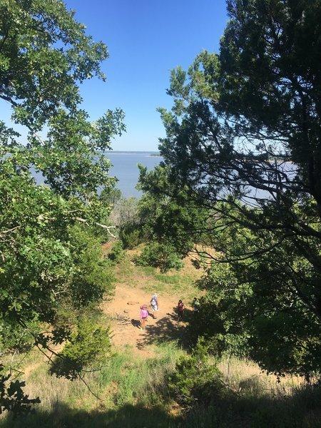 Hikers navigate the beautiful lakeside trail.