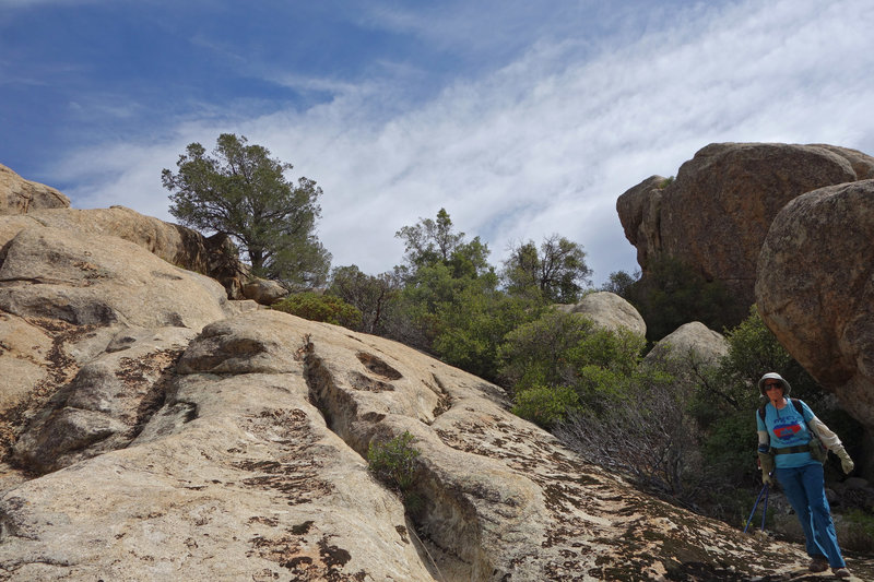 A hiker explores the rocks just east of the Warner Springs section of the PCT.