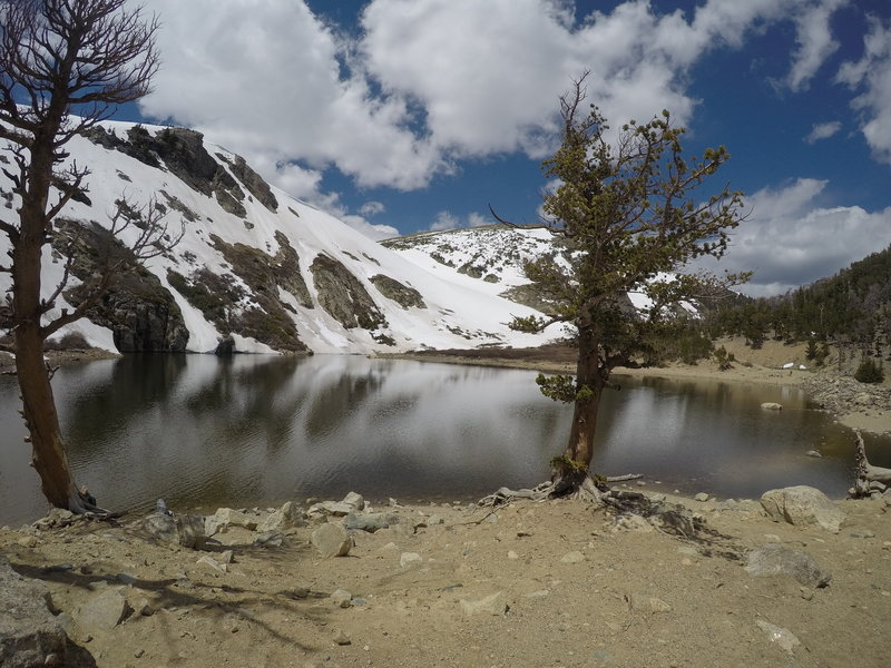 Make a stop at the lake before you head up through the snow for the rest of the trail.