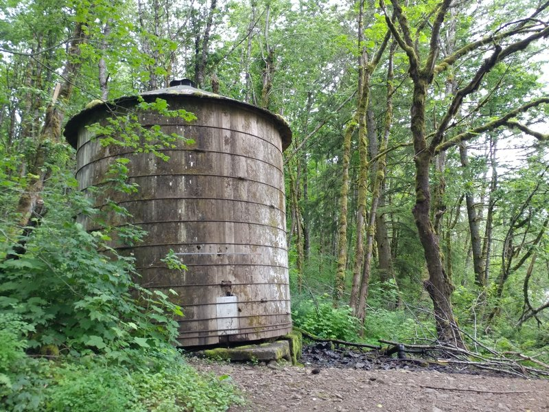 An old water tank lives right near the parking area.