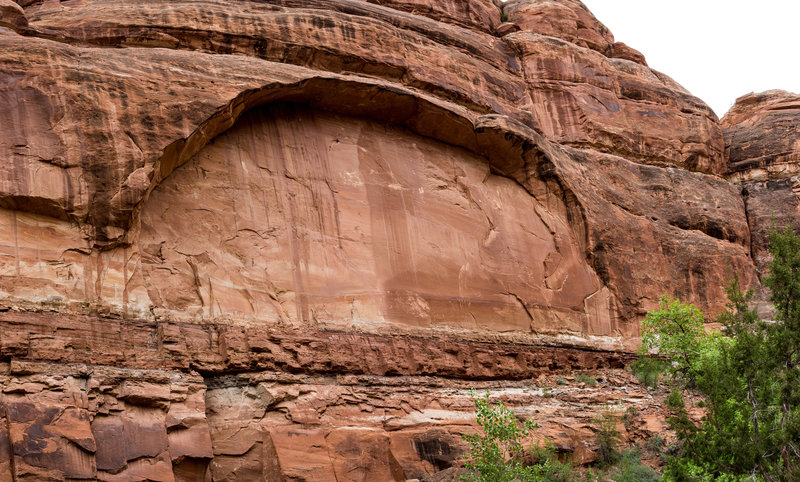 An arch begins to take form in the wall of Owl Creek Canyon.