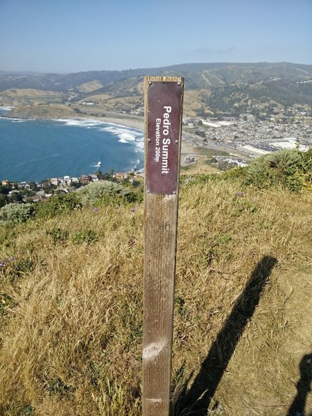 The highest point of the trail is marked by this post.