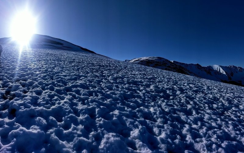 By this point, this snowfield is all that's between you and the false summit/windbreak shelters.