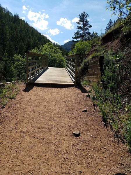 Bridge near Mid-Columbine Trailhead. The trail narrows and gets steeper directly after bridge.