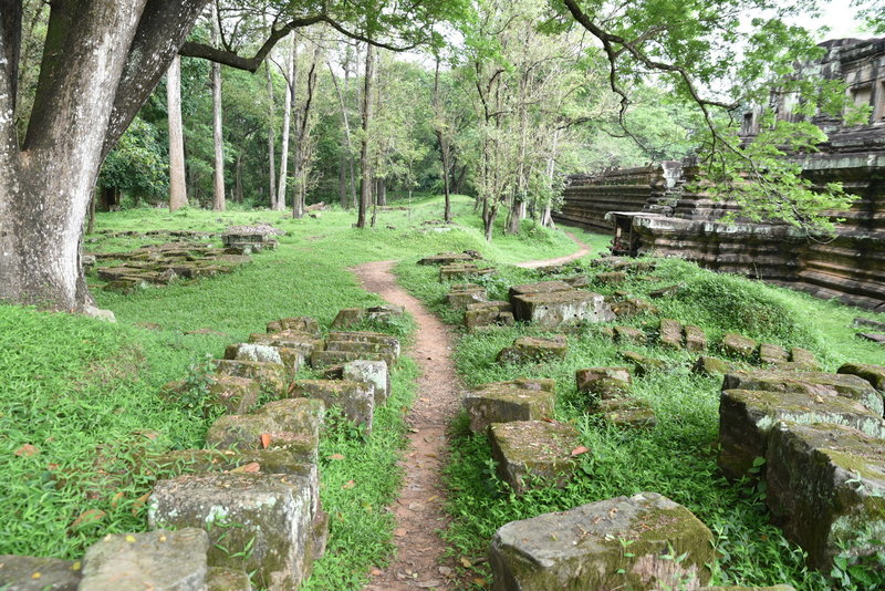 The Baphuon Temple trail wanders past scattered stones.