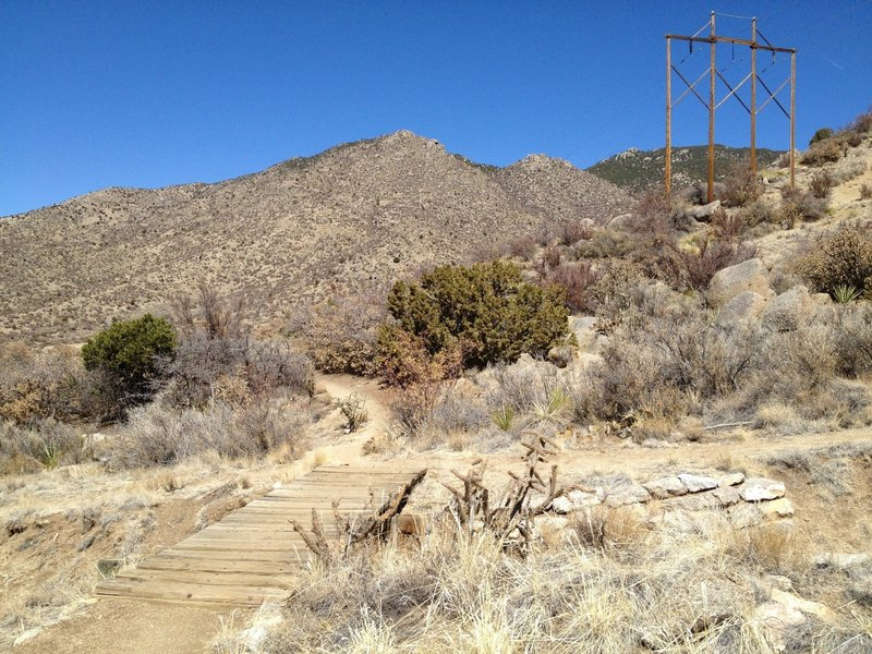 A wooden bridge over an arroyo on the Lower Foothills Trail 365.