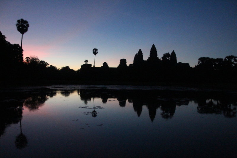 Sunrise from the nearby reflection pool within Angkor Wat.