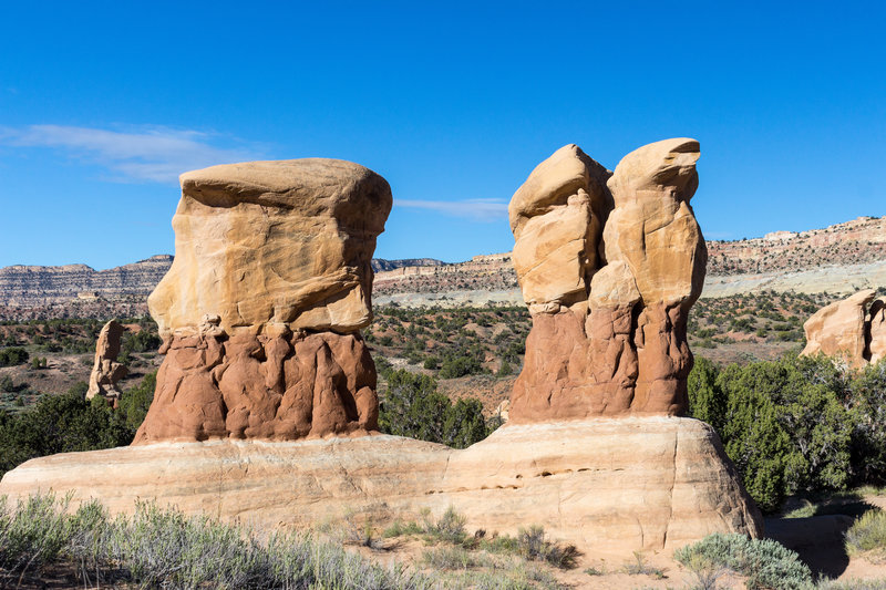 Hoodoos continue to be sculpted in Devils Garden while Fiftymile Mountain stands in the background.