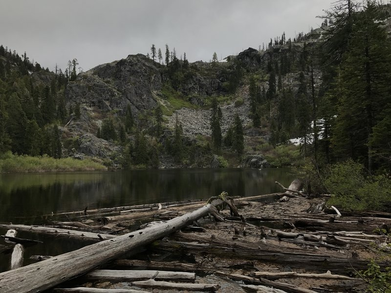 Mill Creek Lake hides in the shadow of a gloomy day in the western Trinity Alps.