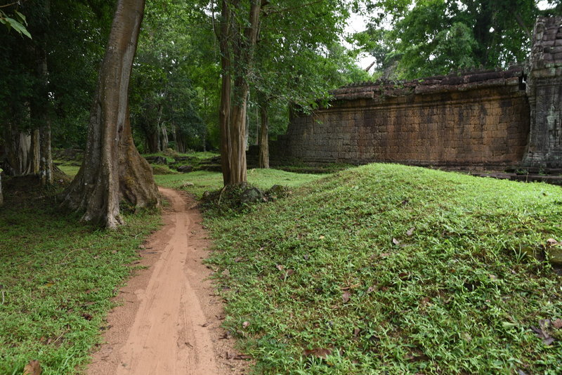 The Preah Khan Trail winds through low grass covered mounds as it loops.