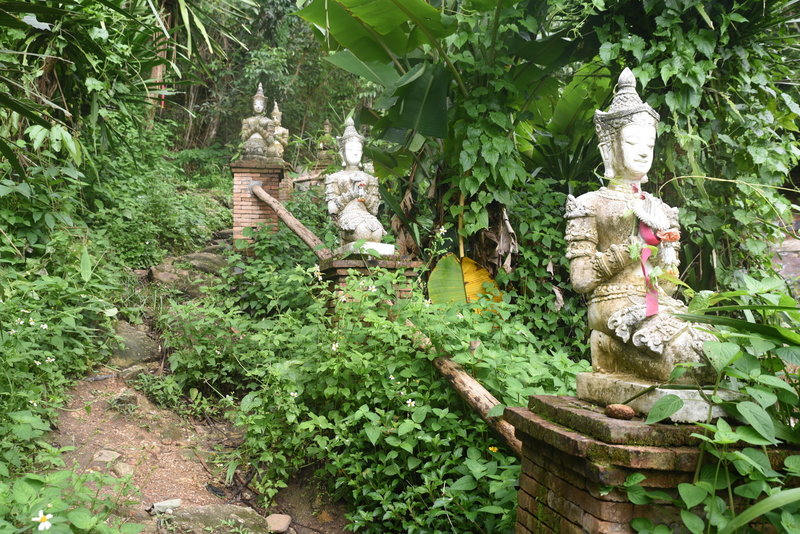 The trail is lined by statues as it approaches the monastery.