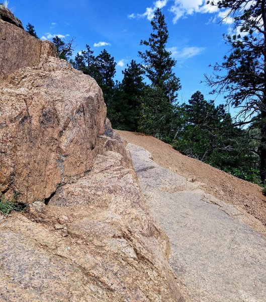 The trail requires climbing over rock slabs and sure footing as you navigate its loose sections.