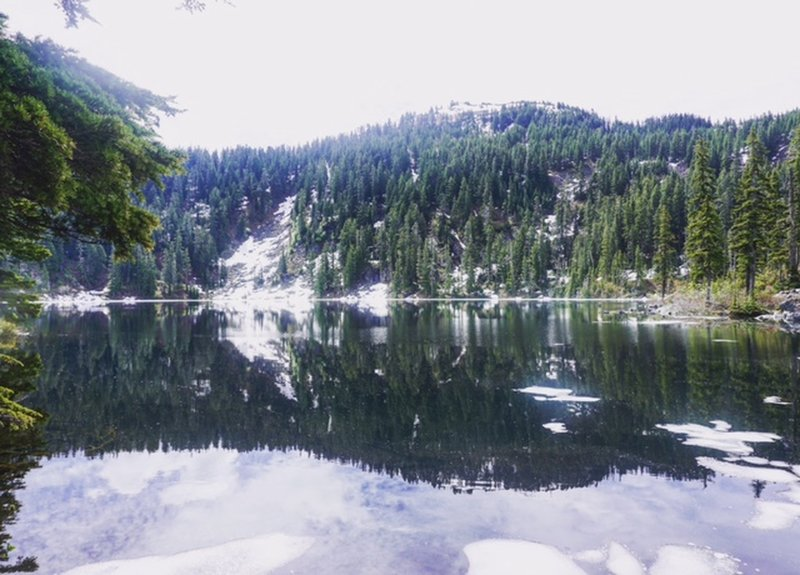 In early summer, almost all of the ice is gone from Mason Lake, leaving a beautiful reflection.