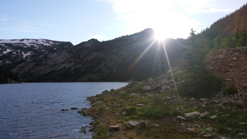 The sun sets over Bass Lake in early July.