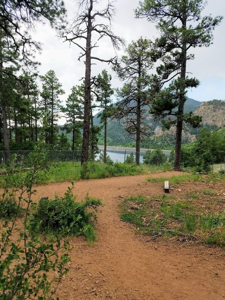 This is the junction of Gold Camp Trail and Chamberlain Trail. Gold Camp Reservoir is in the background.