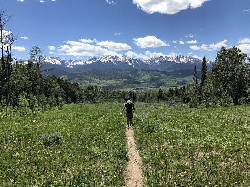 Heading down the Acorn Creek Trail with expansive views of the Gore Range to the west.