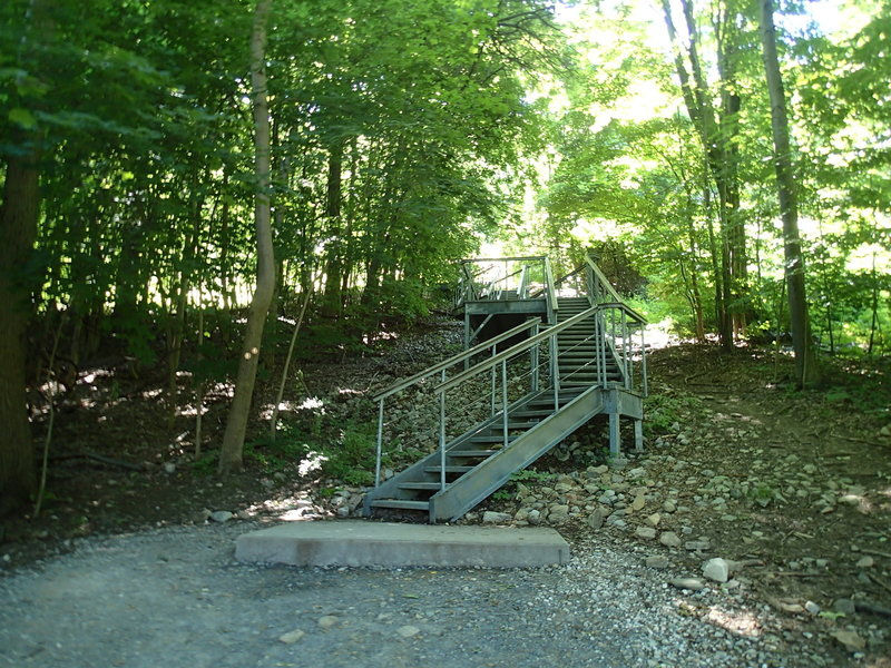 After the gravel path from the parking area is this steel staircase. Upon reaching the top, get ready for a steep trail!