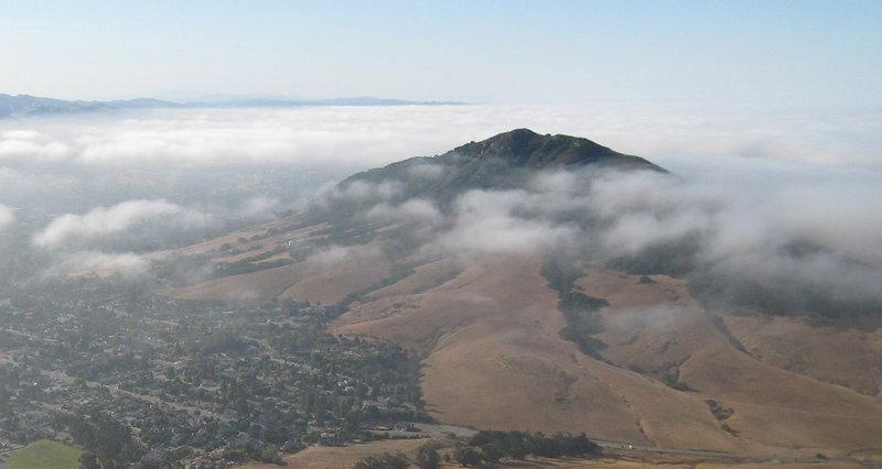 Cerro San Luis peeks through the clouds from Bishop Peak.