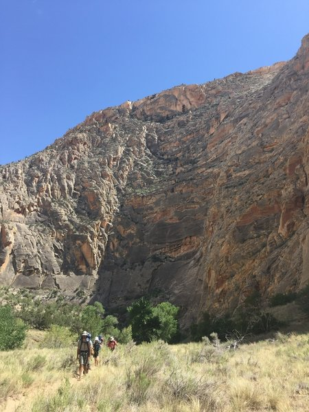 The group grows hot and tired as we hike along the Escalante.