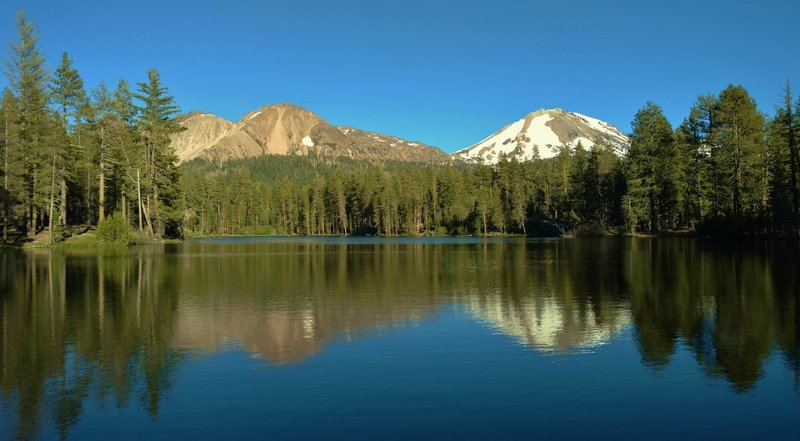 Chaos Crags (left) and Mt. Lassen (right) stand over the east end of Reflection Lake.