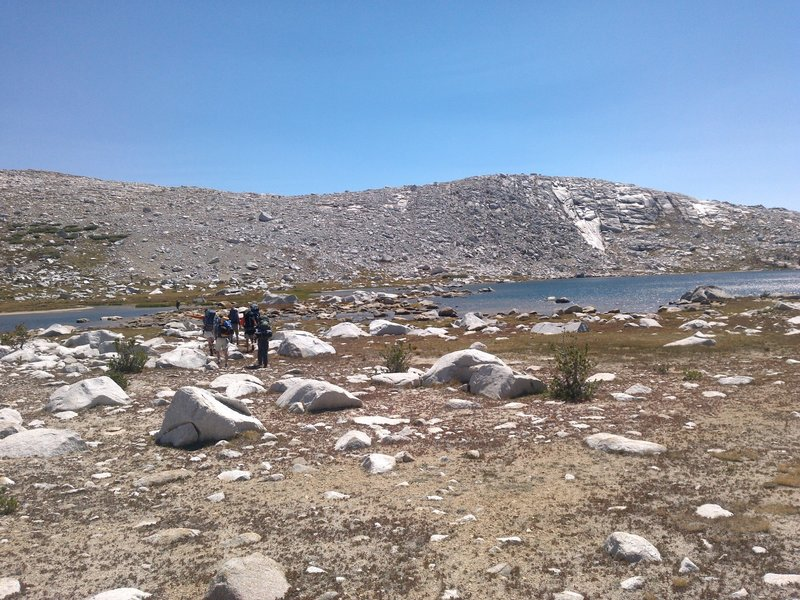 A sunny day brings big smiles to a group near Bighorn Lake on the Blackcap Basin Lakes Route.