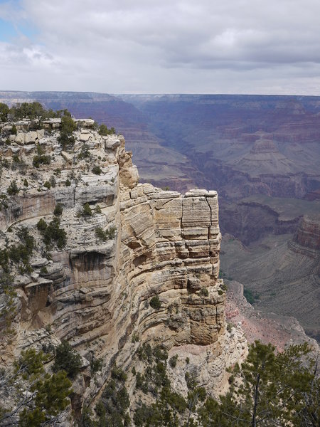 The Battleship juts out over the canyon below.