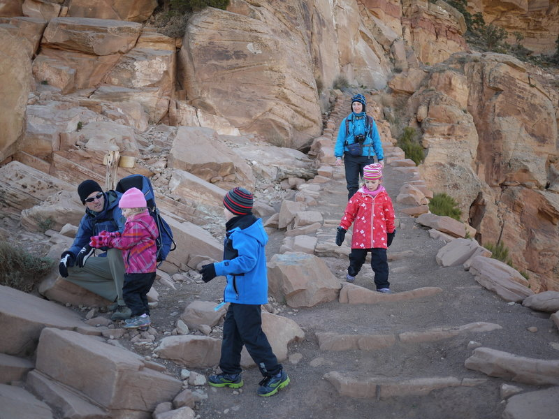 A French family hikes down the South Kaibab Trail near Ooh Aah Point.