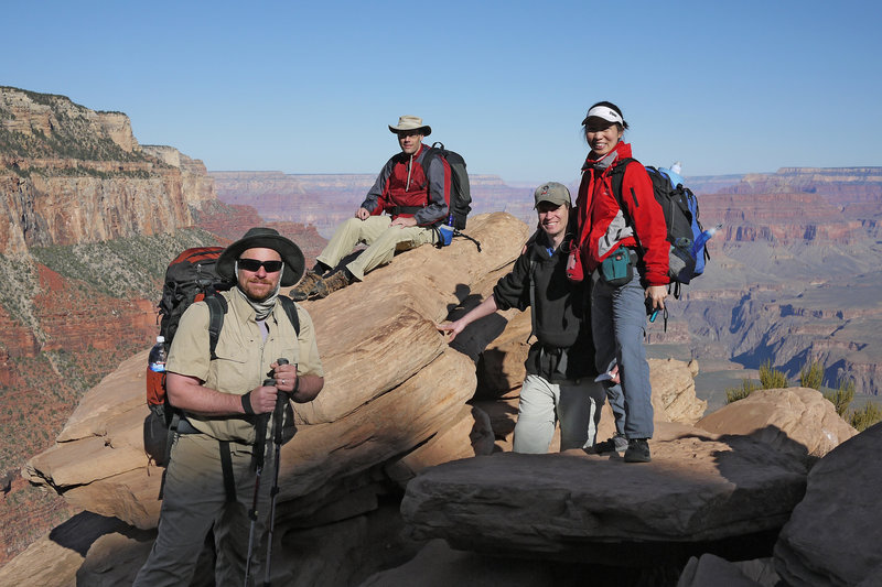 Four hikers take a break at Ooh Aah Point on the South Kaibab Trail.