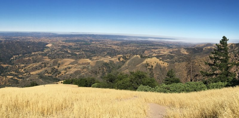 Enjoy great views near the summit looking back toward the town of Los Olivos with coastal fog visible in the distance.