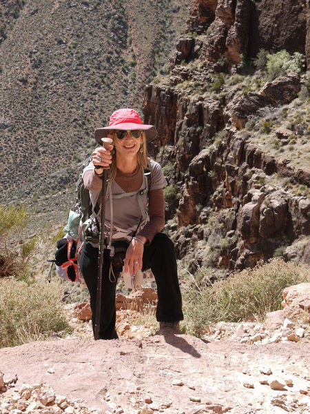 A hiker puts on a brave face for the long ascent of the South Kaibab Trail.