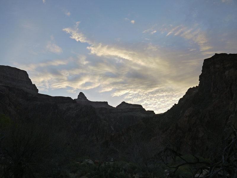 The sun rises over the junction of Bright Angel Canyon and the Colorado River.