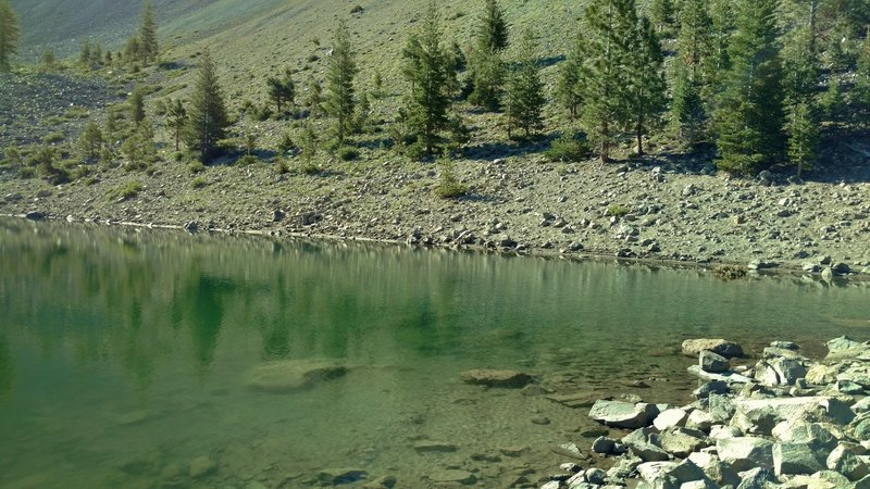 This is the Crags Lake shoreline in Chaos Crater of the Chaos Crags – a cluster of six dome volcanoes.