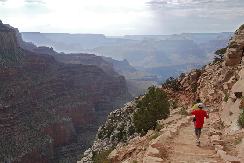 Two young hikers take in the majesty of the Grand Canyon from the South Kaibab Trail.