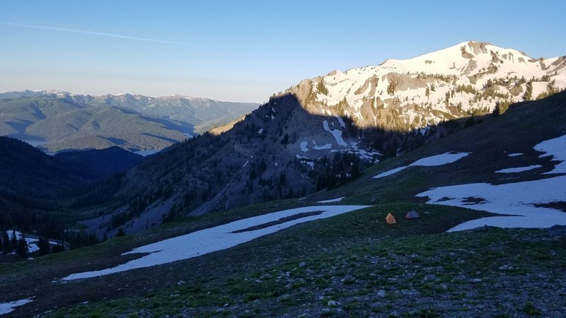 There's a nice flat spot to camp just downhill of the ridge looking toward Sheep Creek Peak.