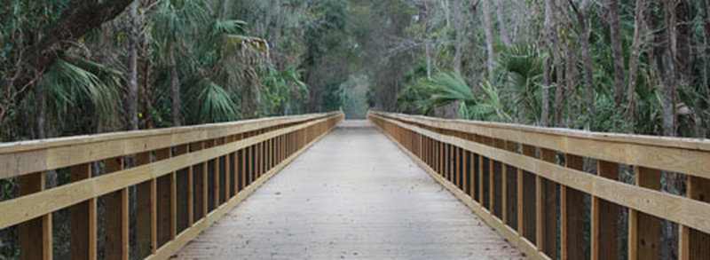 A massive wooden bridge aids your passage along the East Central Rail Trail.