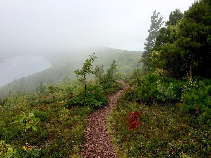 Escarpment trail in fog, with Lake Superior at right, Lake of the Clouds at left.