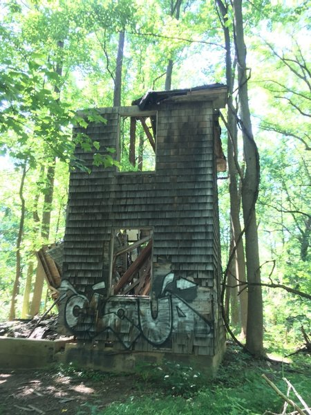 Ruins of an old house, maybe a mill house, with graffiti.
