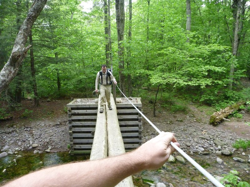 A neat river crossing with a rope railing for balance.
