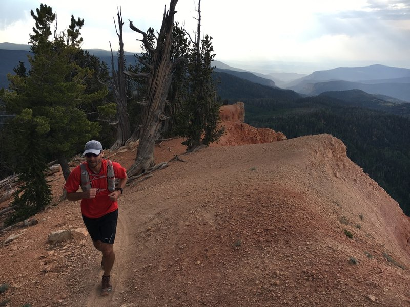 """Randy, skirting the edge of """"the breaks"""" as he makes his way of the Blow Hard Mountain Trail."""