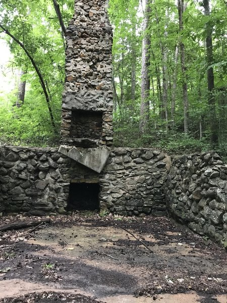 Stone foundation with fireplace.